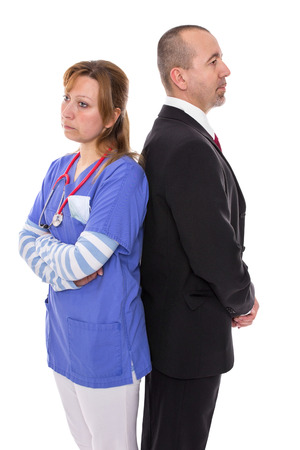 stubborn: Doctor stands back to back with her boss Stock Photo