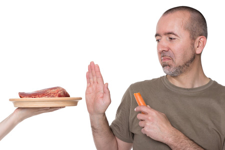 Man rejects offered meat on a plate
