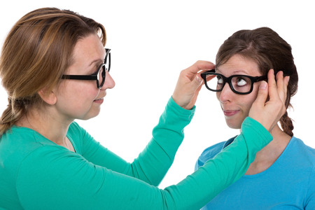 farsighted: Woman lets another woman test some glasses