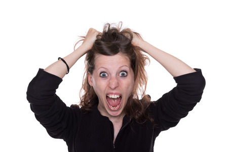 explosives: A woman sccuffles angry her long brown hair Stock Photo