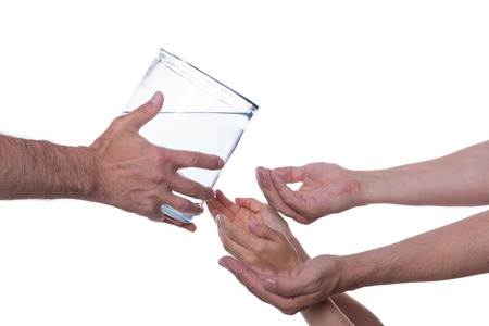 potable: Hands are reaching out to clean drinking water which is served to them