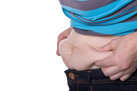 gordos: Mujer toca con las manos en la grasa del vientre Foto de archivo