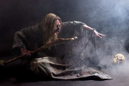 satan: A witch summoning in the dark with a lot of fog Stock Photo