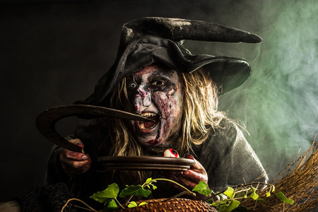 summoning: Witch holds a sickle and a plate with eyes in her hands