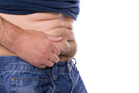hombre flaco: Un hombre cauc�sico toma su vientre lejos peluda