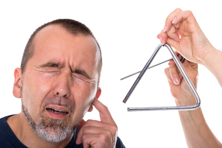 A triangle next to the head of a man in agony