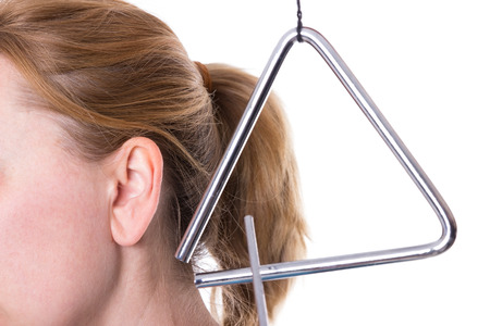 loudness: A triangle in the vicinity of a female ear