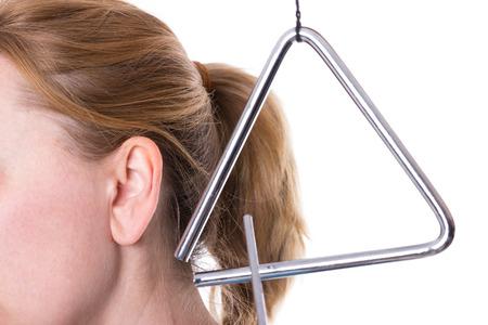 Trojúhelník v blízkosti ženy ucha