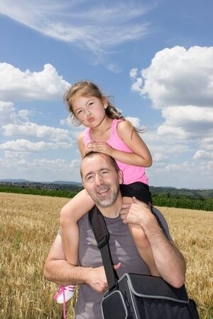 soulfulness: Father and daughter making a trip in the summer Stock Photo