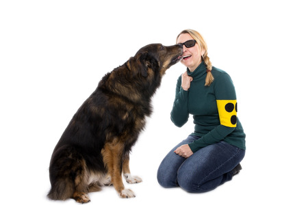faithful: A guide dog shows his mistress his affection Stock Photo