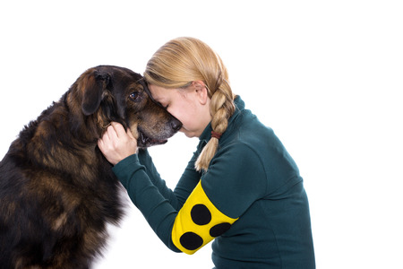grope: Ab blind woman is touching her guide dog and cuddles with him