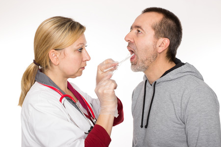 respiratory tract: A doctor is lookin into a patient