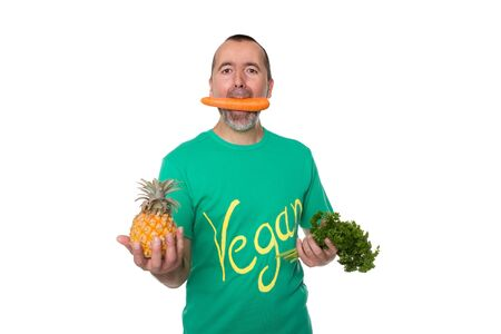 biologically: Man with a carrot in his mouth is standing in front of white a background
