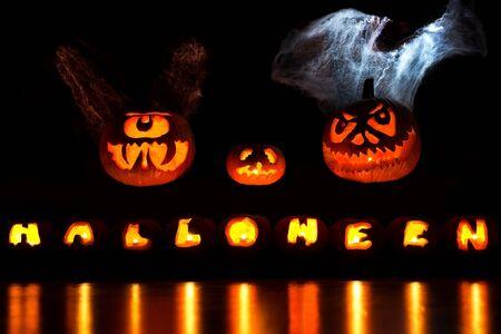hover: Carved Halloween Pumpkins hover over a Halloween insription