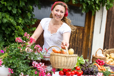likeable: A market woman offers fresh vegetables at a market stall