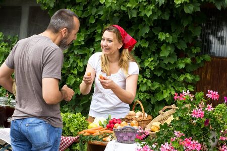 likeable: A man talking to a market woman