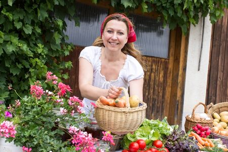 likeable: A peasant woman selling fresh vegetables at the market