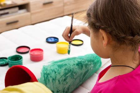 cornet: A little girl painting her school cornet