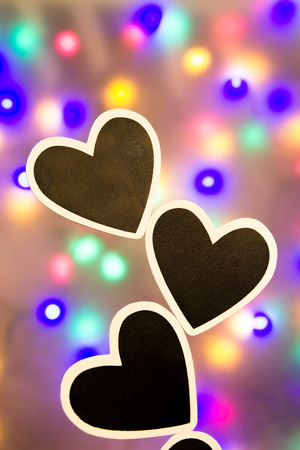 Colorful lighted background with black hearts
