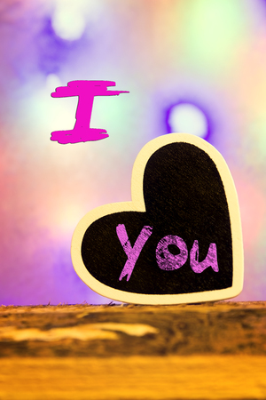 lonliness: A heart in front of a colorful background with the inscription I love you