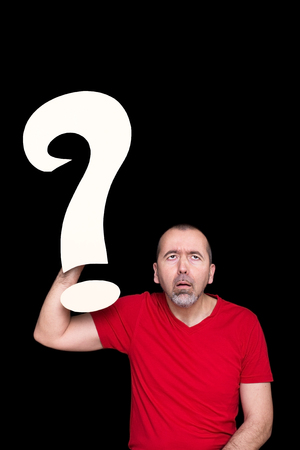 A man looking stupid, holding a question mark in his hand