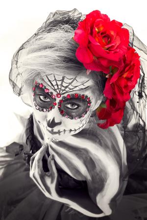 Sugar Skull looks sensual to the camera, color-key