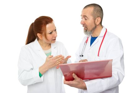 Two doctors discussing a patient file Stock Photo