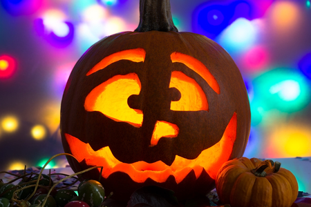 Carved and lit pumpkin on Halloween