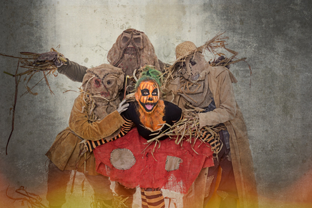 A group of scarecrows and a human squash behind a flame wall Reklamní fotografie