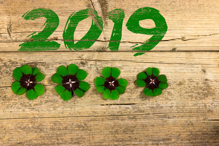 Four four-leaf clovers with the lettering 2019