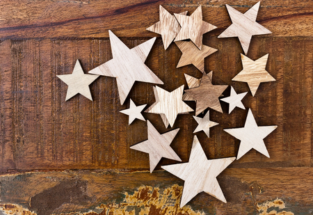 Big and small wooden stars on a vintage wooden table Reklamní fotografie