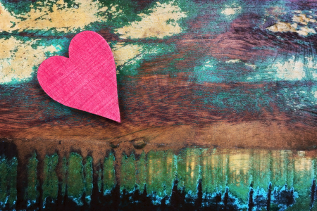 A red heart on an old wooden background Standard-Bild