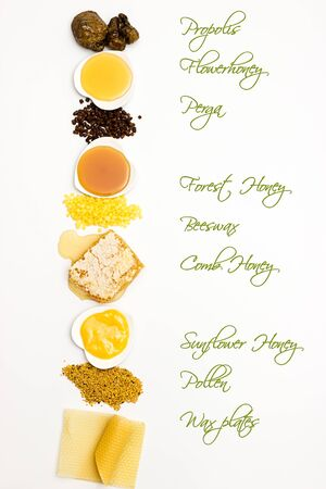 Small list of different bee products on white background with label Stock Photo