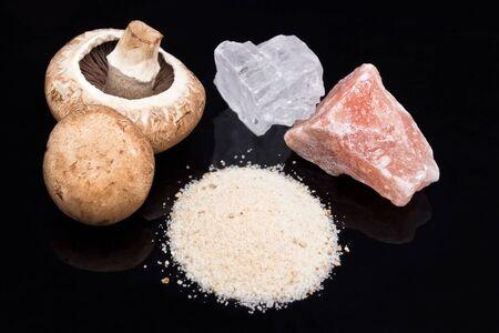 A heap of champignon salt with salt crystal and mushrooms