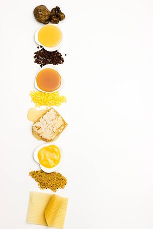 Various varieties of bee products on a white background