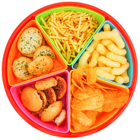 colored container with chips and pretzels for aperitifs seen from above