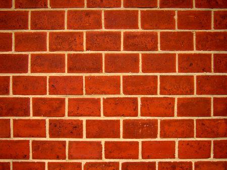 periferia: L'immagine rappresenta un close-up dettagli di un muro con mattoni rossastri.