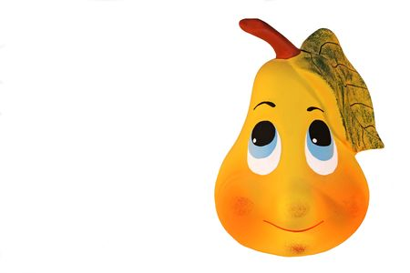 Cute ceramic figurine pear shape- like, with shy expression on its face. photo
