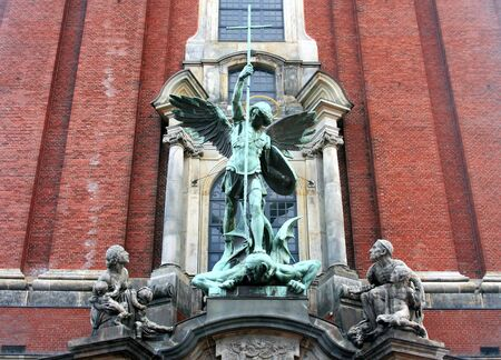 hamburg: Saint Michael�s statue on main entrance of Michael�s church, Hamburg,Germany.