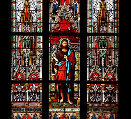 baptist: Saint John, the Baptist, stained glass window in St.Vitus Cathedral, Prague. Stock Photo