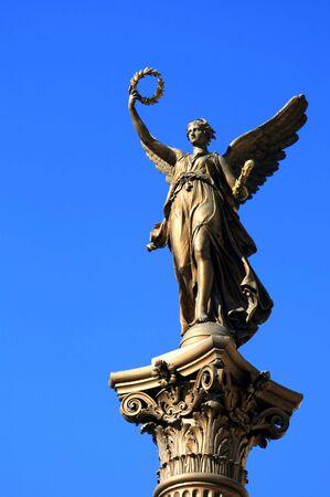 Close-up details of an angel holding the winners crown (Prague,Czech Republic). photo