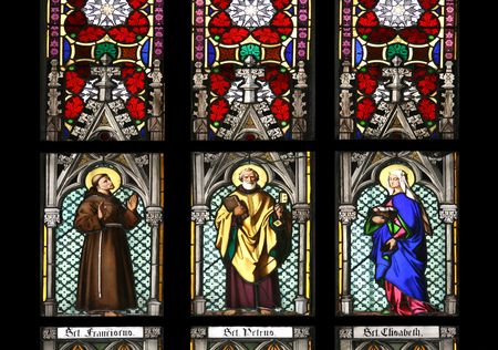 Stained glass window in St.Vitus cathedral, Prague, depicting St. Franciscus, St.Petrus and St. Elisabeth. photo