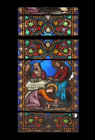 anoint: Stained glass window in St.Samson cathedral, Dol-de-Bretagne, France, depicting a biblical scene: Maria Magdalena anoints Jesus Christs feet.