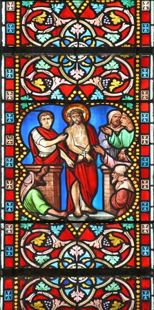 Stained glass window in St.Samson cathedral, Dol-de-Bretagne, France, depicting a biblical scene: Pontius Pilate with Jesus Christ at judgment.