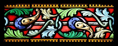 Close up details of a stained glass window in St.Sulpice church (Fougeres, France). Stock Photo
