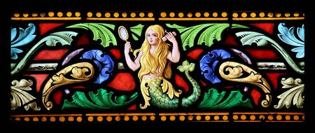 Stained glass window in St.Sulpice church, Fougeres, France, depicting a beautiful blonde mermaid.