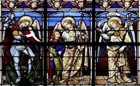 Stained glass window in St.Sulpice church (Fougeres, France), depicting (from left to right) The Archangels: Michael, Raphael and Gabriel.