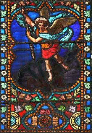 Stained glass window in St.Samson cathedral ( Dol-de-Bretagne, France) depicting The Archangel Michael. photo