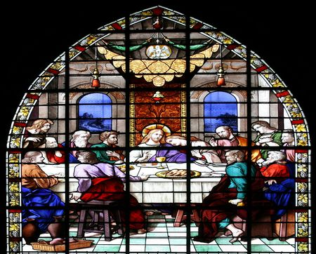 Stained glass window in St.Sulpice church (Fougeres, France), depicting a biblical scene: The Last Supper.