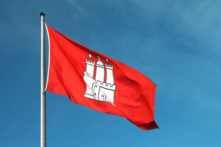 The Hamburg city flag with a blue sky in the background. Editorial